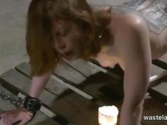 Mistress spanking and toying her tattooed slave