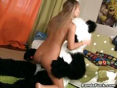 Young slut sucking and riding teddy bear