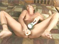 Horny blonde fucks her asshole and pussy with dildos