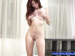 Exquisite dark red-haired babe gives a blowjob