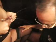 Lingerie wearing mature lady milking cock
