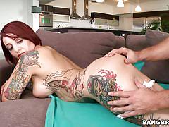 Gorgeous tattooed redhead with big boobs fucking wildly
