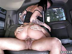Tattooed babe getting hardcore in a bus