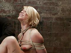 Tied up blonde on the floor getting punished