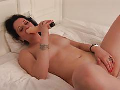 Solo brunette mature and her big dildo