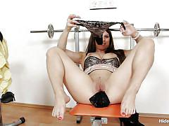 Brunette taking a break from exercising and stuffing her pussy