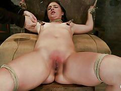 Tied lesbian brunette getting her treatment