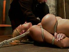 Bondage on the floor with hot busty milf