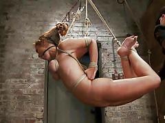 Hanging chick in dark dangerous vault