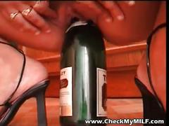 Amateur euro milf riging wine and beer bottles