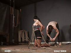 Rope tied busty brunette getting her throat fucked