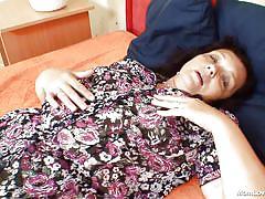 Mature brunette masturbates in the bedroom