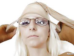 Sexy blonde with dorky glasses masturbates covered in nylon