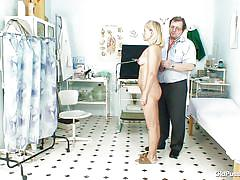 Doctor gives her a thorough examination