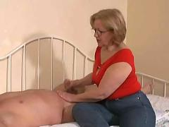 Woman jacking-off a young guy....do not miss!!!