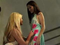 Blond and brunette lesbians toy on the stairs