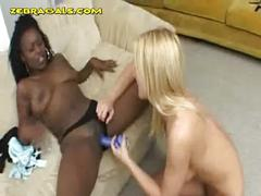 Blonde stuffs dildo in black babe pussy