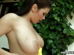 Big tit lesbian babes toying outdoors