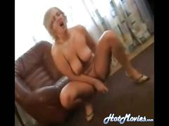 Big titty blonde gives us quite the pussy show