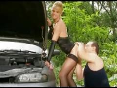 Stunning blonde milf in stockings fucks the mechanic outdoor
