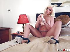 Busty blonde babe drills her pussy with big dildo.