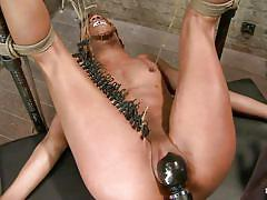 Black vibrator on a tied black slut