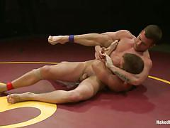 Naked wrestlers in a close combat