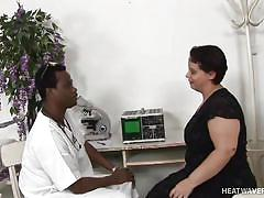 Black doctor examines woman's big boobs