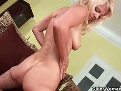 Sultry senior mom probes her old pussy with a large dildo