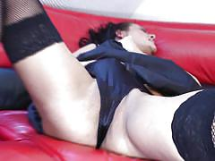 Mature whore masturbating on a red couch