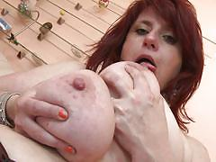 Mature slut plays with her big boobs