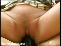 Busty milf mandy riding the mother of all big dildos