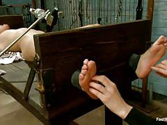 Redhead mistress really likes her feet