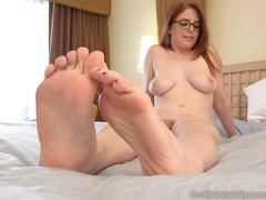 Sexy redhead in stockings has feet fucked and pussy pounded