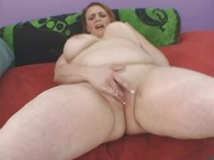 Chubby mature masturbes her shaved pussy