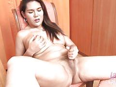 Ladyboy showing her firm tits and jerking off