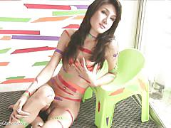 Getting her picture taken makes this ladyboy so horny