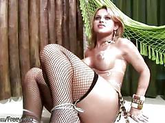 Slutty blonde tgirl in black stockings jerks off big shecock