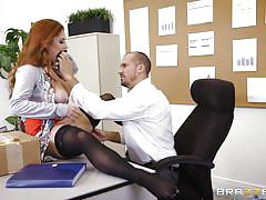 Redheaded beauty shows titfucking skills at work