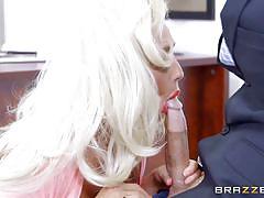 Blonde sucks a massive cock at work