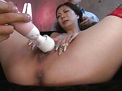 Asian slut gapes her cunt