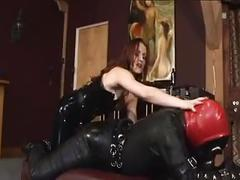 Latex mistress using her slave