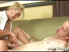 Busty blonde milf gives a wet handjob
