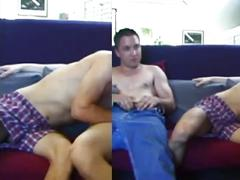 Threeway cock sucking on the couch