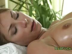 Beautiful brunette gets massage with oil