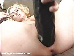 Samantha pounding a massive dildo in closeup