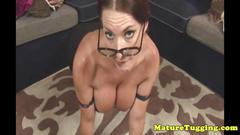 Busty posing milf model tugging the cameraman