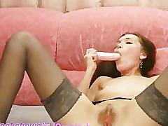 Brunette in black stockings dildos her pussy