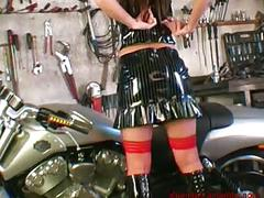 Brunette girl strips and poses on a motorbike