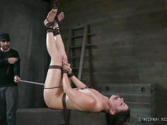 Dungeon slut is tied up and whipped